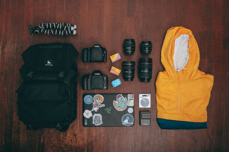 the best luggage backpack for digital nomads laid out on the table along with all the things to go inside
