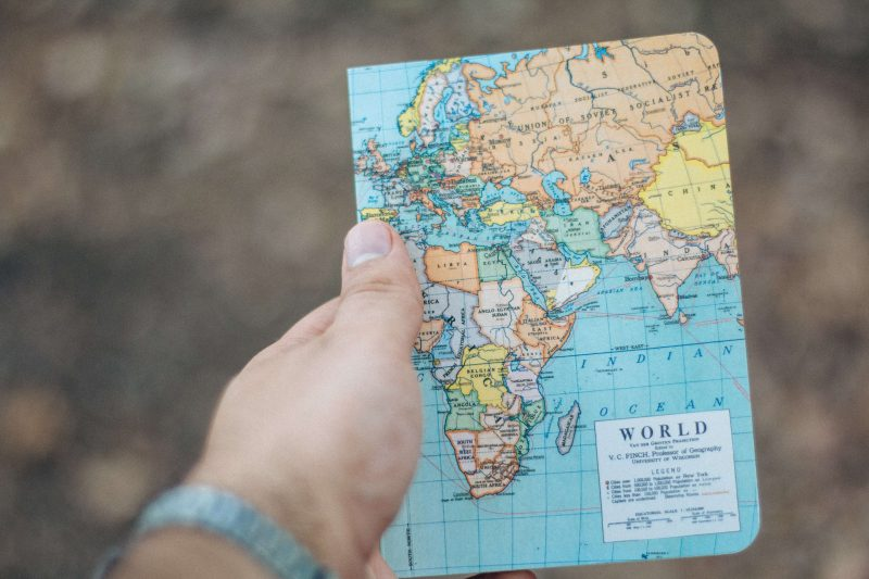a journal being given as a gift to a digital nomad