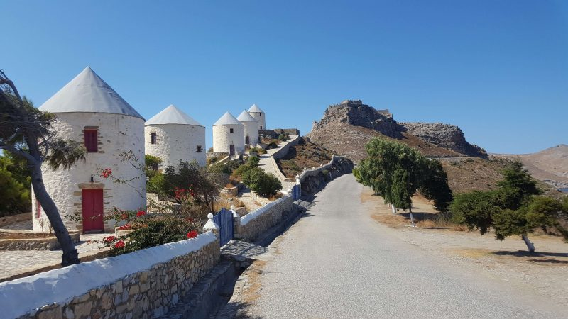 the white windmills on leros island in greece