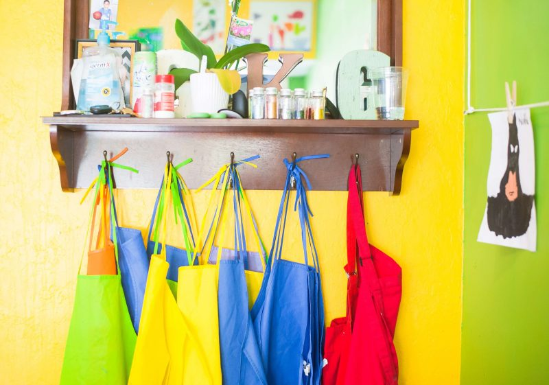aprons hanging on a wall in homeschool