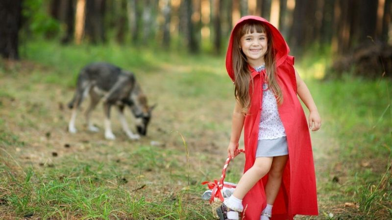 a girl dressed as red riding hood for a fairy tale lesson hook