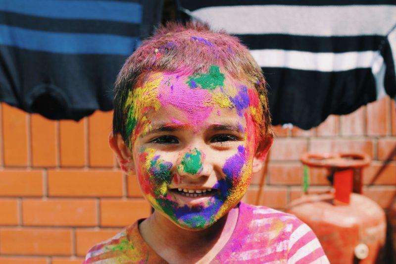 A child at a homeschool festival having fun
