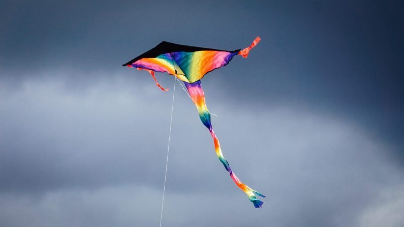 a kite flying as a winter outdoor activity for kids
