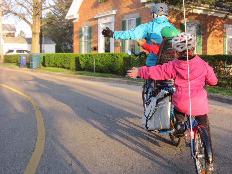 kids outdoors in winter on a bike ride