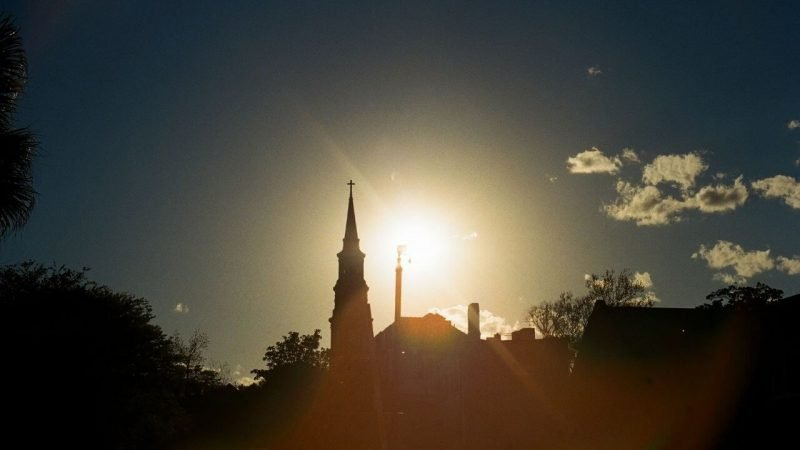 Charleston at night with the sun setting behind an iconic church