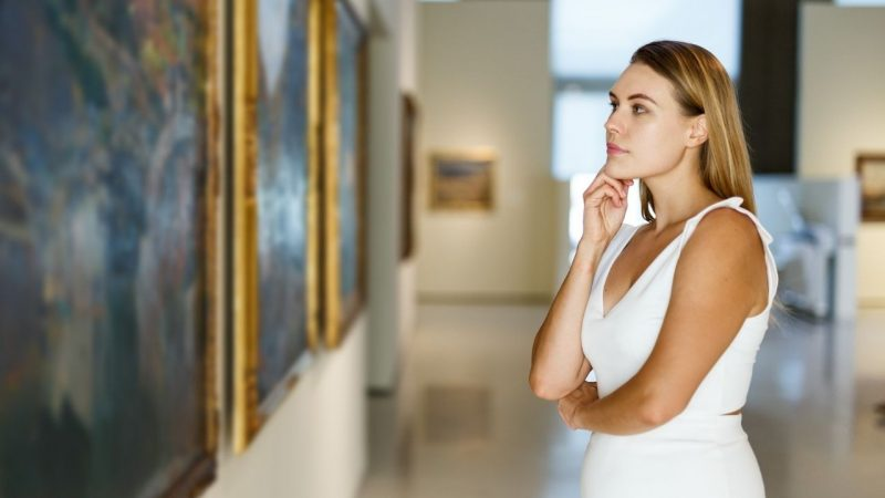 A girl on one of the best things to do in Charleston - an art and history tour