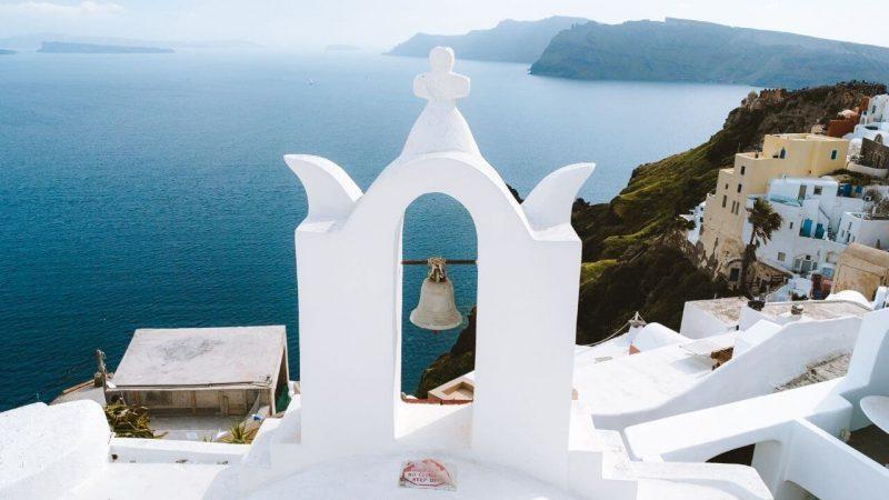 a pretty greek church on a hill