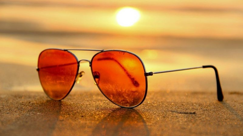 The best sunglasses for sailing on a beach at sunset